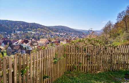 Fence in the mountains with a view of the historic half-timbered houses of the city of Wernigerode. Saxony-Anhalt, Germany