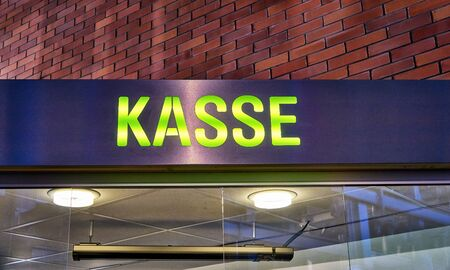 Cash register as backlit text in German. Letters with Kasse means cash box.