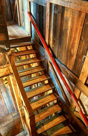 Old wooden stairs in a house. Фото со стока