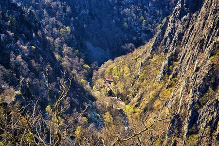 Houses in the valley between the mountains. Bodetalschlucht in Saxony-Anhalt, Harz, Germany