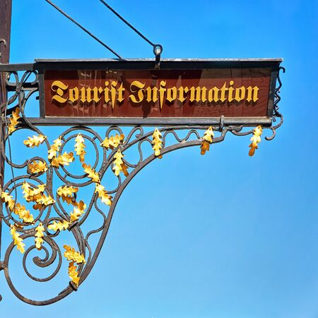 Tourist information as text in old traditional script.