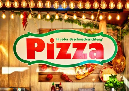 Pizza shop sign with nice lighted background.