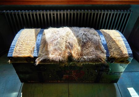 Old wooden vintage chest with fur on the lid. Antique wooden box as a vintage background.