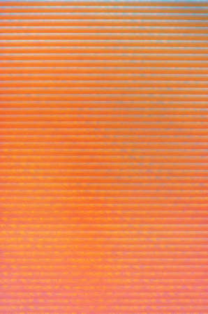 Orange pink colored abstract background with pattern stripes and gradient. 免版税图像
