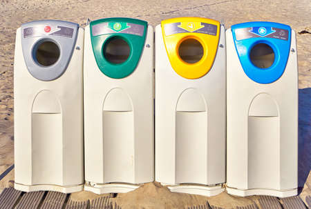 Modern garbage sorting containers on a public beach with a new recycling concept in Germany.