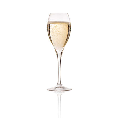 Cold fancy champagne bubbling and fizzing in transparent glass goblet on white background