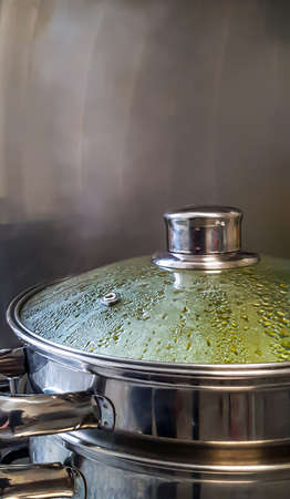 Silver steamer pot cooking homemade food close-up. Banque d'images