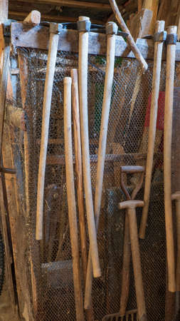 Traditional handmade farming tools kept in the stable 免版税图像