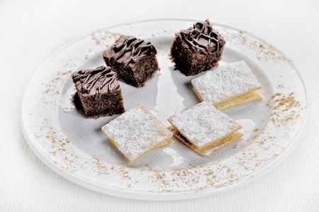 Delicious Chocolate Brownies and Alfajores. On a white background. 写真素材