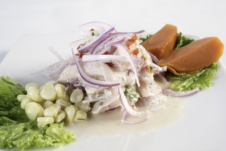 Ceviche, dish symbol of Peruvian gastronomy. On a white background.