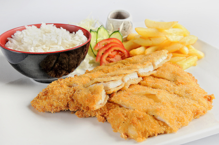 Fish dish - fried cod fillet with vegetables and rice.