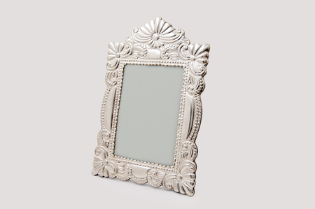 Silver frame for paintings, mirrors or photos. On a white background.