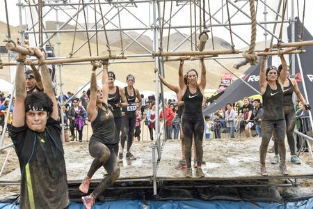 LIMA, PERU - OCTOBER 23, 2016: Inka Challenge, an extreme obstacle course where 1500 athletes from different countries managed to cross the finish line at Santa Maria beach. Challenge in the water.
