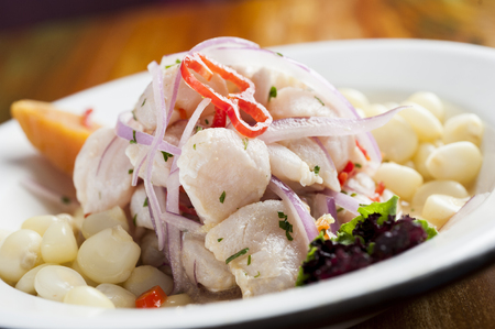 Ceviche, dish symbol of Peruvian gastronomy on a wooden table.