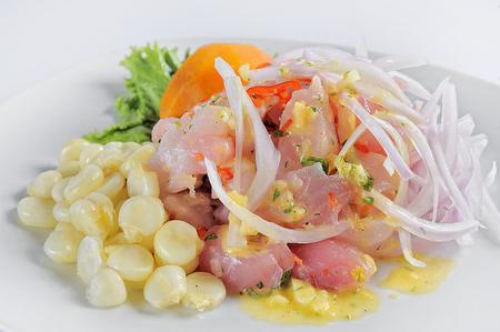 Ceviche, dish symbol of Peruvian gastronomy. On a white background.