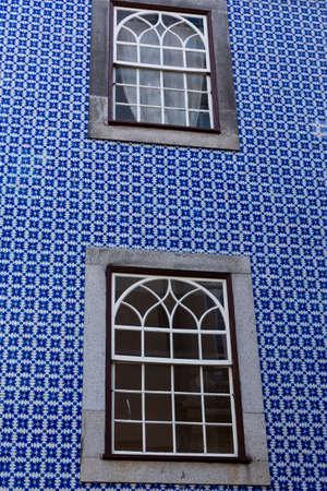 Traditional Portuguese facade with two windows. Porto