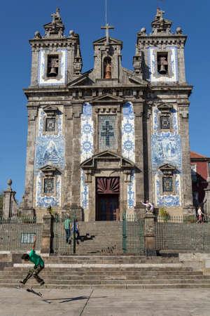 Santo Ildefonso church, with skater doing tricks. Porto, Portugal