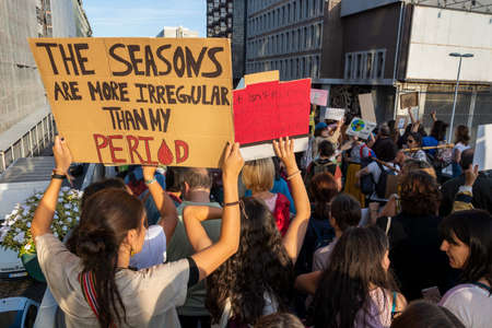 People with placards and posters on global strike for climate change. Porto, Portugal Editorial
