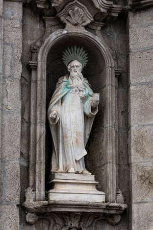Stone statue of a saint, in the facade of Carmo church. Porto, Portugal