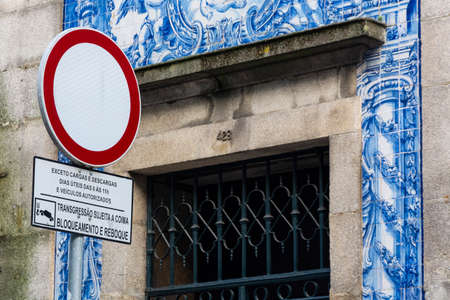 Prohibitory traffic sign with blue building in the background. Traditional portuguese tiles. Porto, Portugal