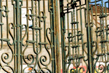 Vintage rusty iron gate, of a church. Green old iron gate. Porto, Portugal