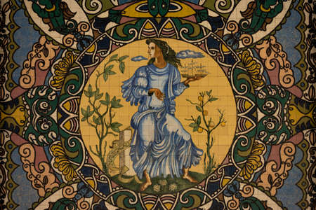 Porto, Portugal - 11/27/2019: Porto, Portugal. Beautiful painting in portuguese traditional tiles. Colorful painting of a woman with a lot of different patterns