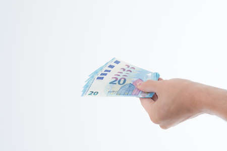 hand held: Revised Twenty Euro Note in hand held - revised design Stock Photo
