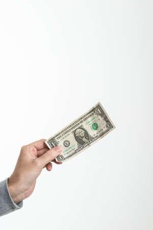 validez: 1 dólar americano en la mano