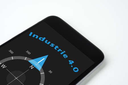 handig kompas industrie met tekst en pijl 4.0. Stockfoto