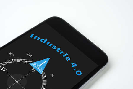 factory automation: handy compass industry with text and arrow 4.0. Stock Photo