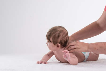 physiotherapy and osteopathy with baby. Stock Photo