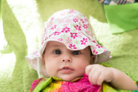 rigid: Baby expressive portrait with hat. Stock Photo