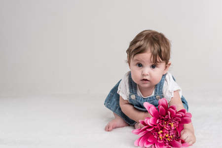 Baby with pink flower cute. Stock Photo