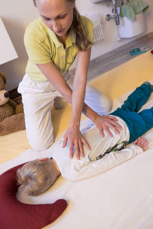 Shiatsu back massage therapist kid.