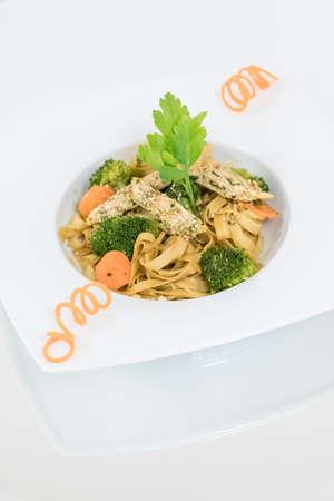 brokkoli carrot meat sesame noodles.
