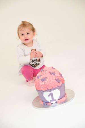 first birthday cake pink girl. Standard-Bild