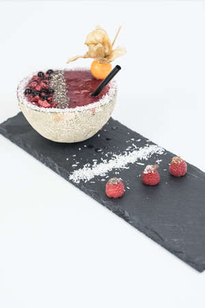 berries dessert on black plate isolated. Stock Photo