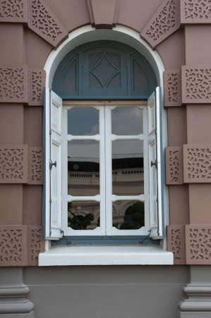 white window brown facade house. Stock Photo
