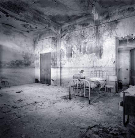 seamy: Decrepit and aged hospital room. Begining of XX century. Border between France and Spain Stock Photo