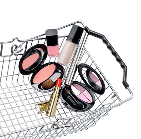 makeups: Shopping basket with a make up set