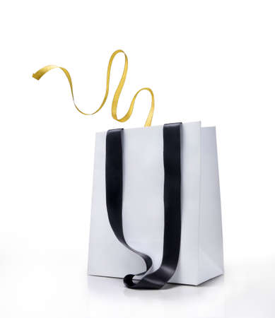 Shopping bag and gift ribbon on white background photo