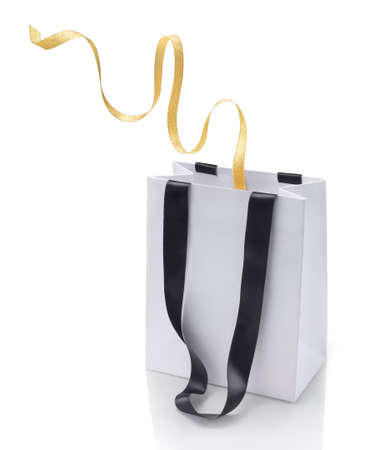 Shopping bag and gift loop on white background photo
