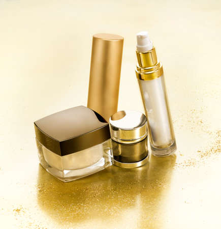 cosmetics collection: Cosmetics in gold environment with small gold nuggets