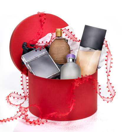 perfume bottle: Perfumes in red festive box Stock Photo