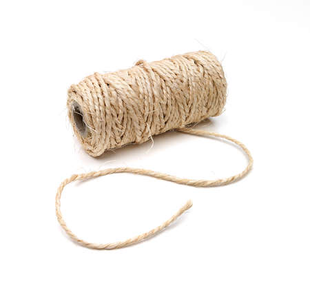 clew: Curved thick string and a roll on white background with a soft shadow