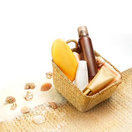 beachbag: Suntan creams in a beach basket  Stock Photo