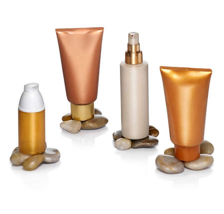 Four generics sunscreen containers concept  Clipping path photo