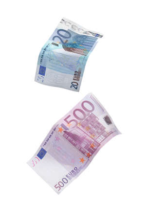 Two euro bills falling on white background photo