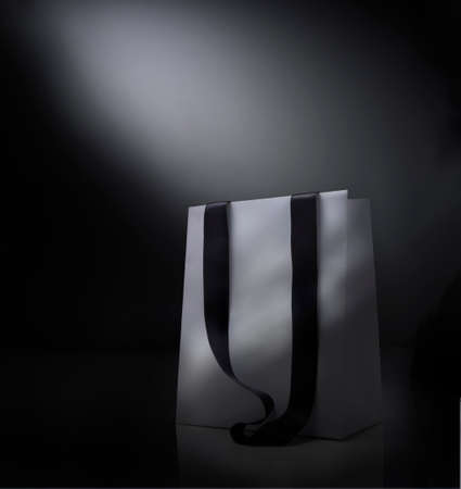 Fantasy shopping bag against  black background photo