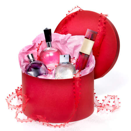 Perfumery gift set in a red box on white background. With a Christmas bow and a little of purpurin effect. Stock Photo
